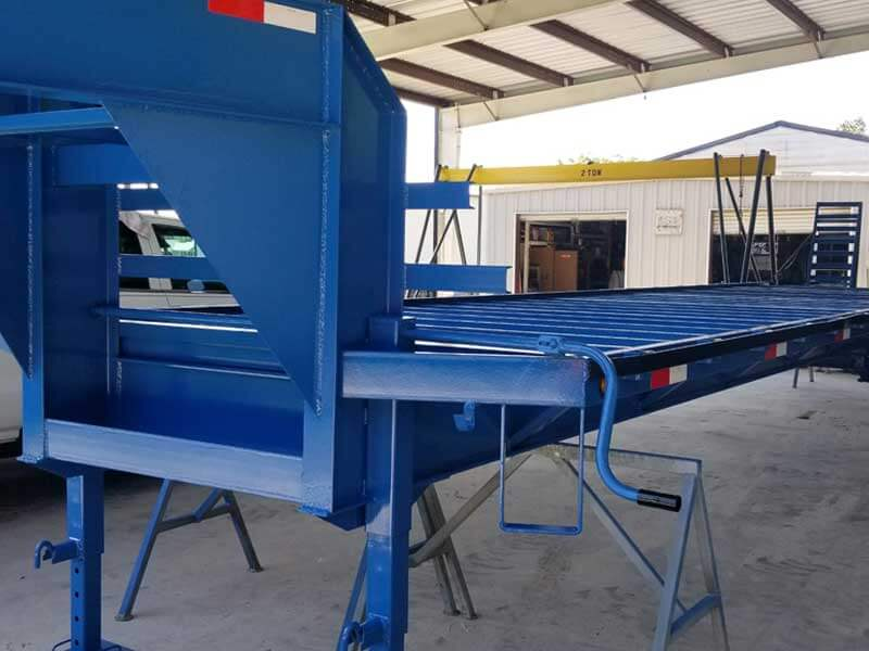 Sand Blasting and painting blue trailer